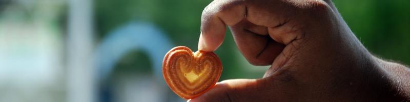 heartshape biscuit in hand