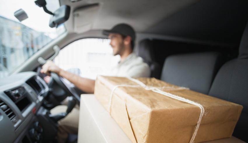 guy delivering package in van