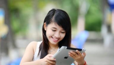 happy girl using tablet