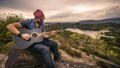 singer singing on mountain