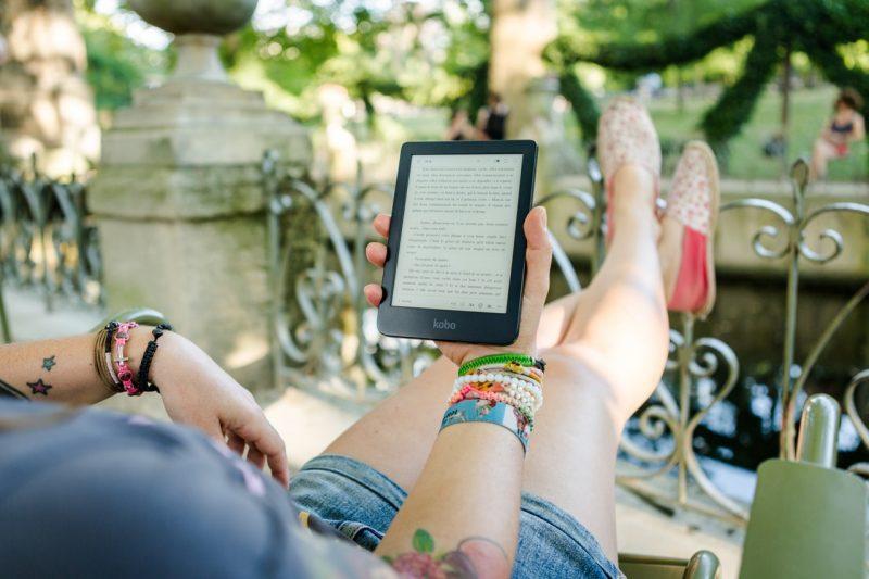 girl reading ebook on tab
